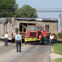 The blacksmith shop building moving to the Sonnenberg Village turning onto Hackett Rd.