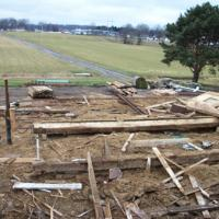 site after dismantling of barn